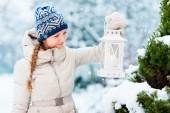 Young woman with Christmas lantern — Stock Photo