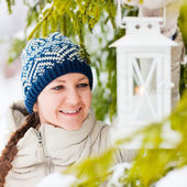 Young woman with Christmas lantern — Stock Photo
