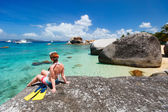 Woman with snorkeling equipment at tropical beach — Stock Photo