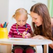 Mother and daughter drawing together — Stock Photo #54699287