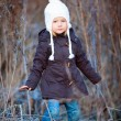 Little girl outdoors on winter day — Stock Photo #54699707