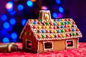 Gingerbread house decorated with colorful candies — Stock Photo