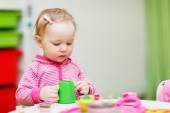 Toddler girl playing with toys — Stock Photo