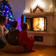 Family at home on Christmas eve — Stock Photo #55312863