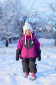 Little girl outdoors on winter day — Stock Photo