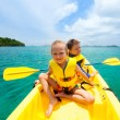 Kids kayaking in ocean — Stock Photo #55884827
