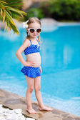 Little girl near swimming pool — Stock Photo