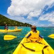 Family kayaking at tropical ocean — Stock Photo #57671885