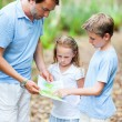 Father and kids with map hiking — Stock Photo #59213743
