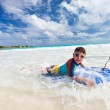 Father and son boogie boarding — Stock Photo #59744061