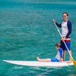 Father and son paddling — Stock Photo #60253777