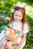 Little girl playing with Easter eggs — Stock Photo