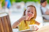 Little girl eating ice cream — Stock Photo