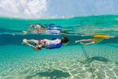 Kids having fun swimming on summer vacation — Stock Photo
