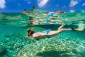 Woman snorkeling in tropical water — Stock Photo