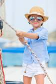 Little girl at luxury yacht — Stock Photo