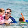 Father with kids at beach — Stock Photo #63818689