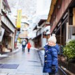 Little girl at town in Japan — Stock Photo #66997137