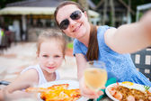Mother and daughter at restaurant — Stock Photo
