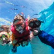 Father and son snorkeling — Stock Photo #68882073