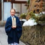 Little girl wearing yukata — Stock Photo #72537835