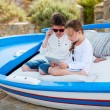 Brother and sister playing on tablet device — Stock Photo #74146063