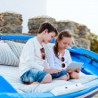 Brother and sister playing on tablet device — Stock Photo #74146073