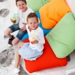 Two kids drinking smoothies outdoors — Stock Photo #74146121