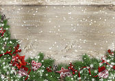 Grunge wood background with Christmas firtree, holly,mittens — Стоковое фото