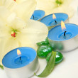 Fine lilies and candles — Stock Photo #52675269