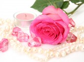 Pink rose and candle — Stockfoto