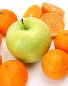 Ripe tangerines and apple — Stock Photo