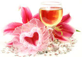 Wine and lily flower — Stock Photo