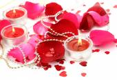 Candles and petals of roses — Stock Photo