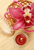 Pink orchid and candles — Stock Photo