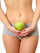 Woman in underwear holding apple — Stock Photo