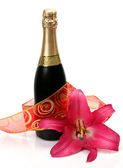 Champagne and pink lily — Stock Photo