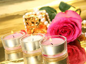 Pink rose and candles — Stock Photo