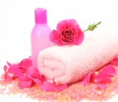 Bottle, towel and rose — Stock Photo