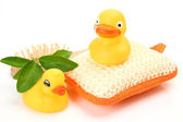 Rubber ducks and bathing bast — Stock Photo