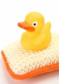 Rubber duck and bathing bast — Stockfoto