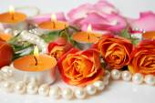 Roses, candles and pearls — Stock Photo