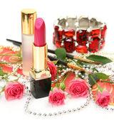 Lipstick, roses and bracelet — Stock Photo