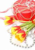 Tulips and gift — Stock Photo