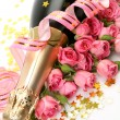 Pink roses and champagne — Stock Photo #54717379