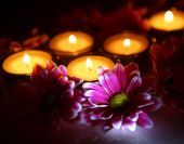 Chrysanthemums  and candles — Stock Photo