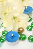 Lilies and candles — Stock Photo