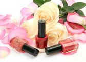 Petals of roses and nail polish — Stock Photo