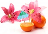 Oranges with decorations for a cocktail and lilies — Stock Photo