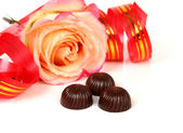 Rose and chocolates — Stock Photo